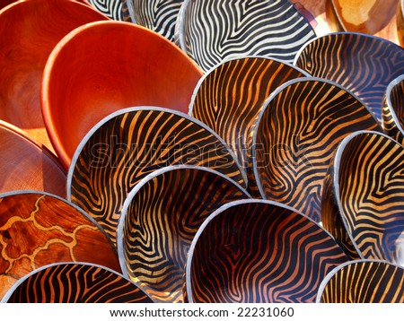 Hand made wooden bowls carved from the wood of indigenous African trees - stock photo
