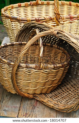 hand made wooden wattled basket old-fashioned in farm - stock photo