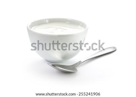 Hand-made yogurt in a bowl with spoon isolated on white background - stock photo