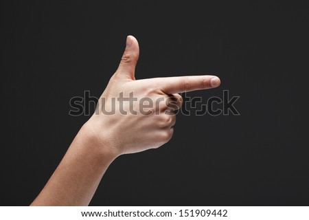 hand making a shooting gesture - stock photo