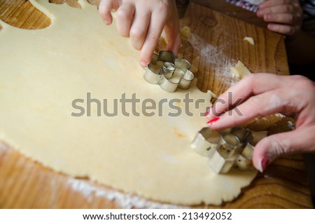 Hand making Ginger Cookie - stock photo