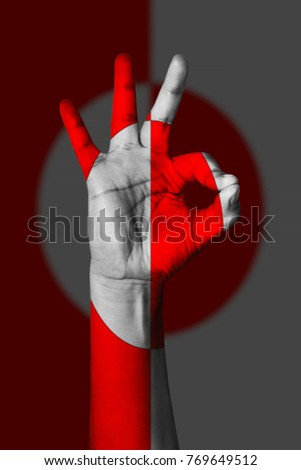 Hand making Ok sign, Greenland flag painted as symbol of best quality, positivity and success - isolated on flag background