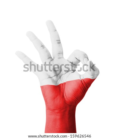 Hand making Ok sign, Poland flag painted as symbol of best quality, positivity and success - isolated on white background - stock photo