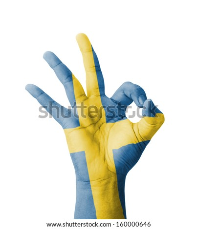Hand making Ok sign, Sweden flag painted as symbol of best quality, positivity and success - isolated on white background