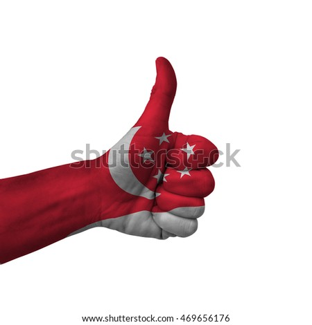 Hand making thumbs up sign, singapore painted with flag as symbol of thumbs up, like, okay, positive  - isolated on white background