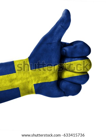 Hand making thumbs up sign.Sweden painted with flag as symbol of thumbs like,up,okay. Isolated on white background.