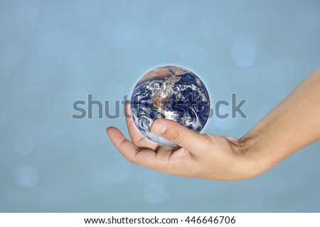 hand male gesture holding the worldon on blurred cyan turquoise blue wavy water background, human hands with healthy world concept, love and safe conception.Elements of this image furnished by NASA - stock photo