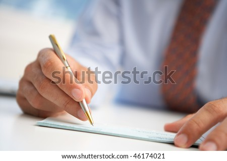 hand man signed check - stock photo