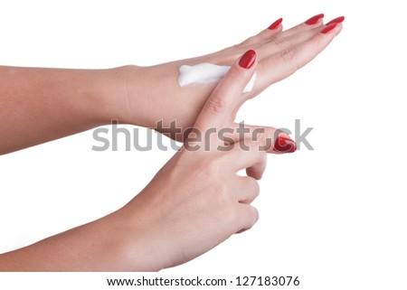Hand massage with cream isolated on white background - stock photo