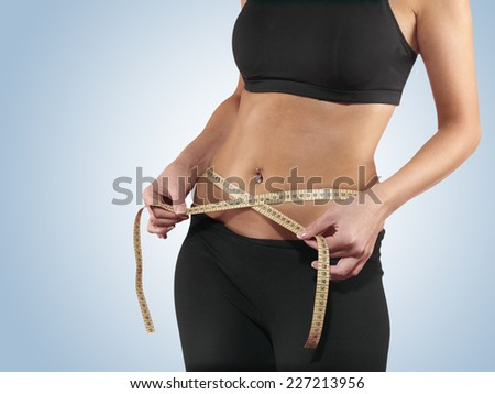 Hand measuring waist, weight loss concept. - stock photo