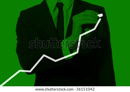 hand of a businessman drawing diagram, monochromatic green - stock photo