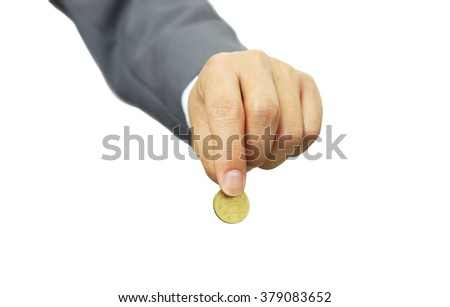 Hand of a businessman holding a golden coin - stock photo
