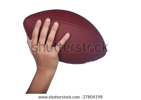 Hand of a child holding or passing an isolated football - stock photo