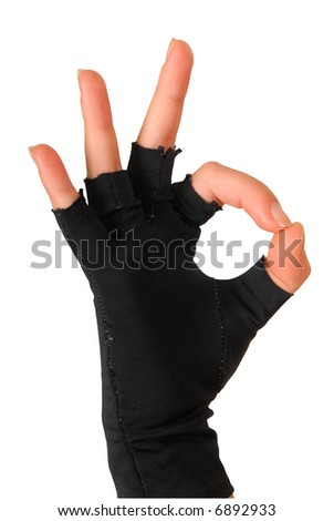 hand of a girl in black glove showing that everything is super - stock photo
