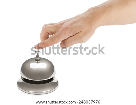 Hand of a man ringing hotel bell isolated on white background.