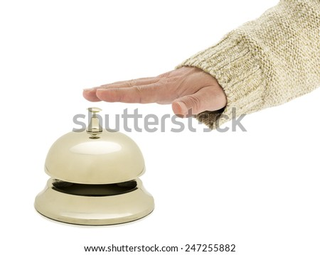 Hand of a man using hotel bell isolated on white background.