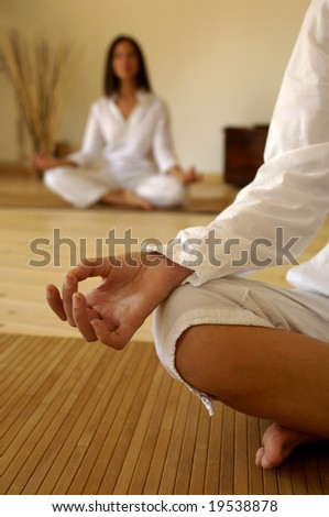 Hand of a woman doing yoga - stock photo