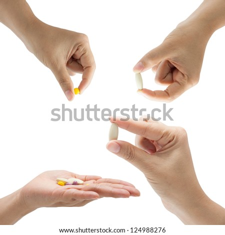 hand of a woman holding a pill