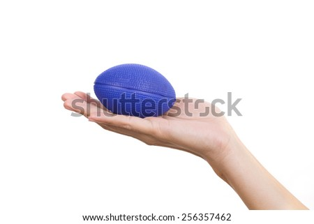 Hand of a woman squeezing a stress ball  - stock photo