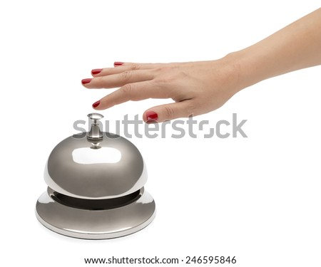 Hand of a woman using hotel bell isolated on white background.