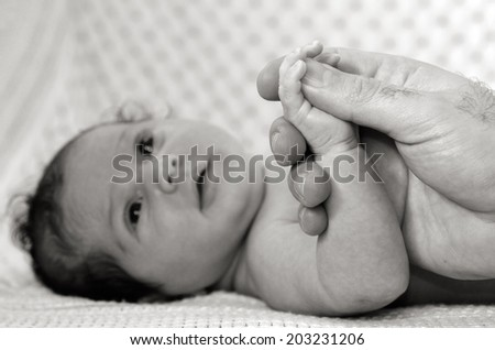 Hand of a young father touch his newborn baby hand.(BW) copyspace - stock photo