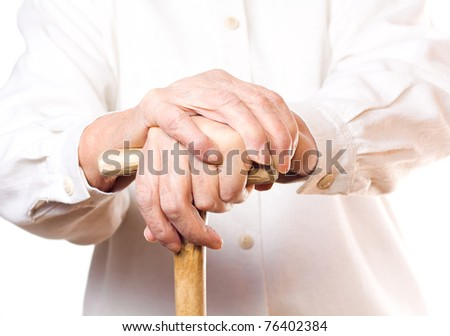 hand of an old man in white, with isolated background - stock photo