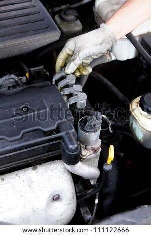 Hand of auto mechanic. Car repair service. - stock photo