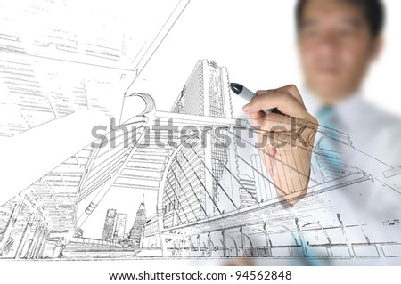 Hand of business man draw building and cityscape - stock photo
