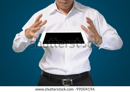 Hand of Business Man hold white tablet pc on blue background - stock photo