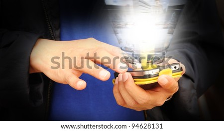 Hand of business man touch screen of mobile device to search streaming images - stock photo