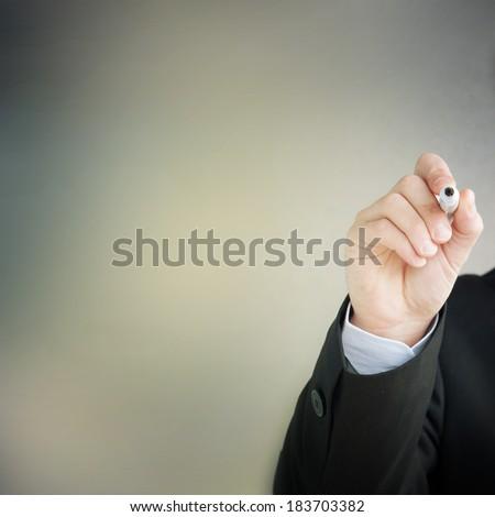 Hand of business man write - stock photo