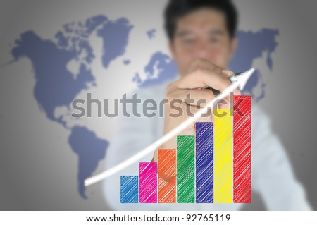 Hand of business man write a business graph on tablet pc touch screen - stock photo