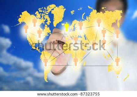 Hand of business man write a social network chart or diagram with world map - stock photo