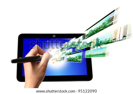 Hand of Business Man write on Touch screen of Tablet PC with Flying Streaming Image and Video. - stock photo