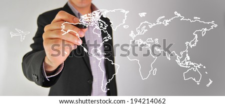 Hand of business man write world map on tablet pc touch screen - stock photo