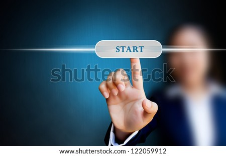 hand of business women pushing a button on a touch screen interface on start button - stock photo
