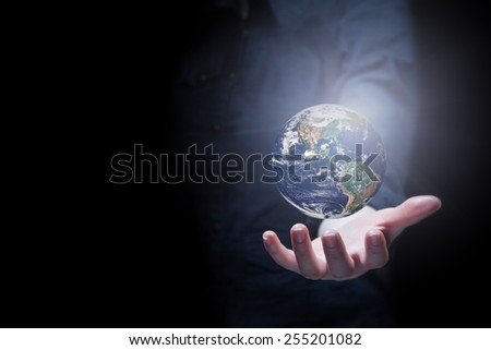 Hand of businesswoman holding earth planet. Elements of this image are furnished by NASA - stock photo