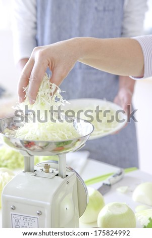 Hand of couples who cook together - stock photo