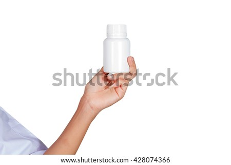 hand of doctor holding Many pills and tablets and medicine isolated on white background - stock photo