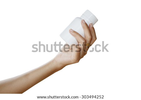 hand of doctor holding medicine bottle on white background
