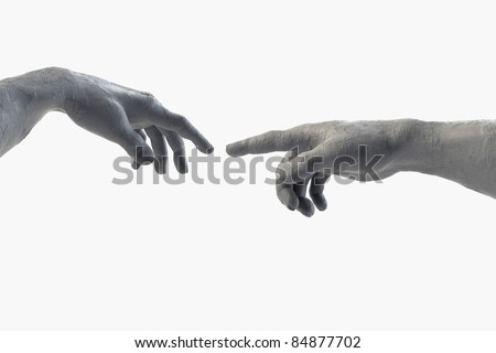 Hand of God and Adam made of sculpting clay on white - stock photo
