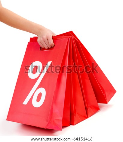 Hand of lady carrying red paper bags