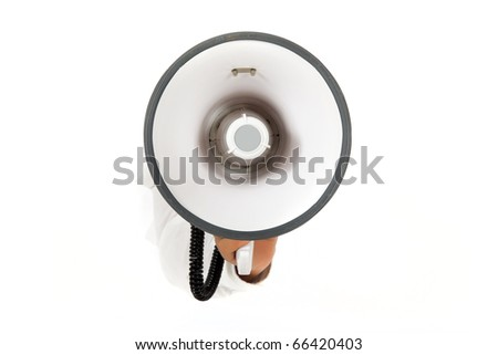 Hand of man breaking through a paper wall holding megaphone. Copy space. Studio shot. White background. - stock photo