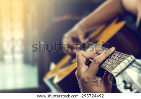 hand of man in classical guitar