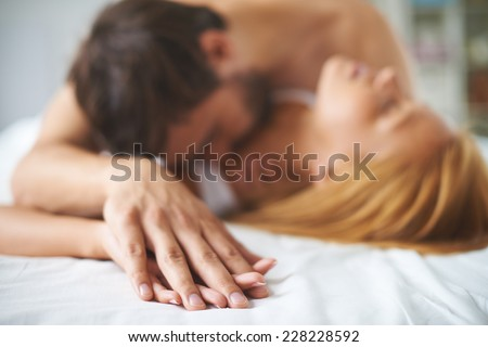 Hand of man in that of a woman - stock photo