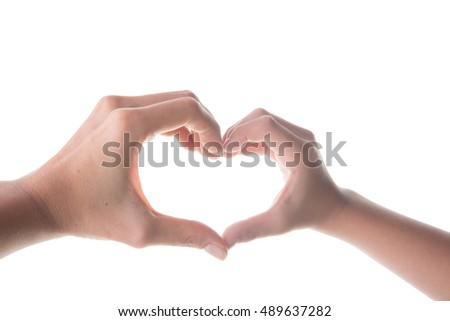 Hand of mom and son making heart shape together