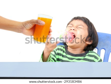 Hand of mother give orange juice for children, who are tired of food,  - stock photo