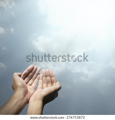 Hand of muslim people praying with abstract background - stock photo
