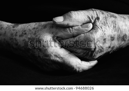 Hand of old woman in black and white