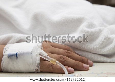 hand of patient lying on hospital bed  - stock photo